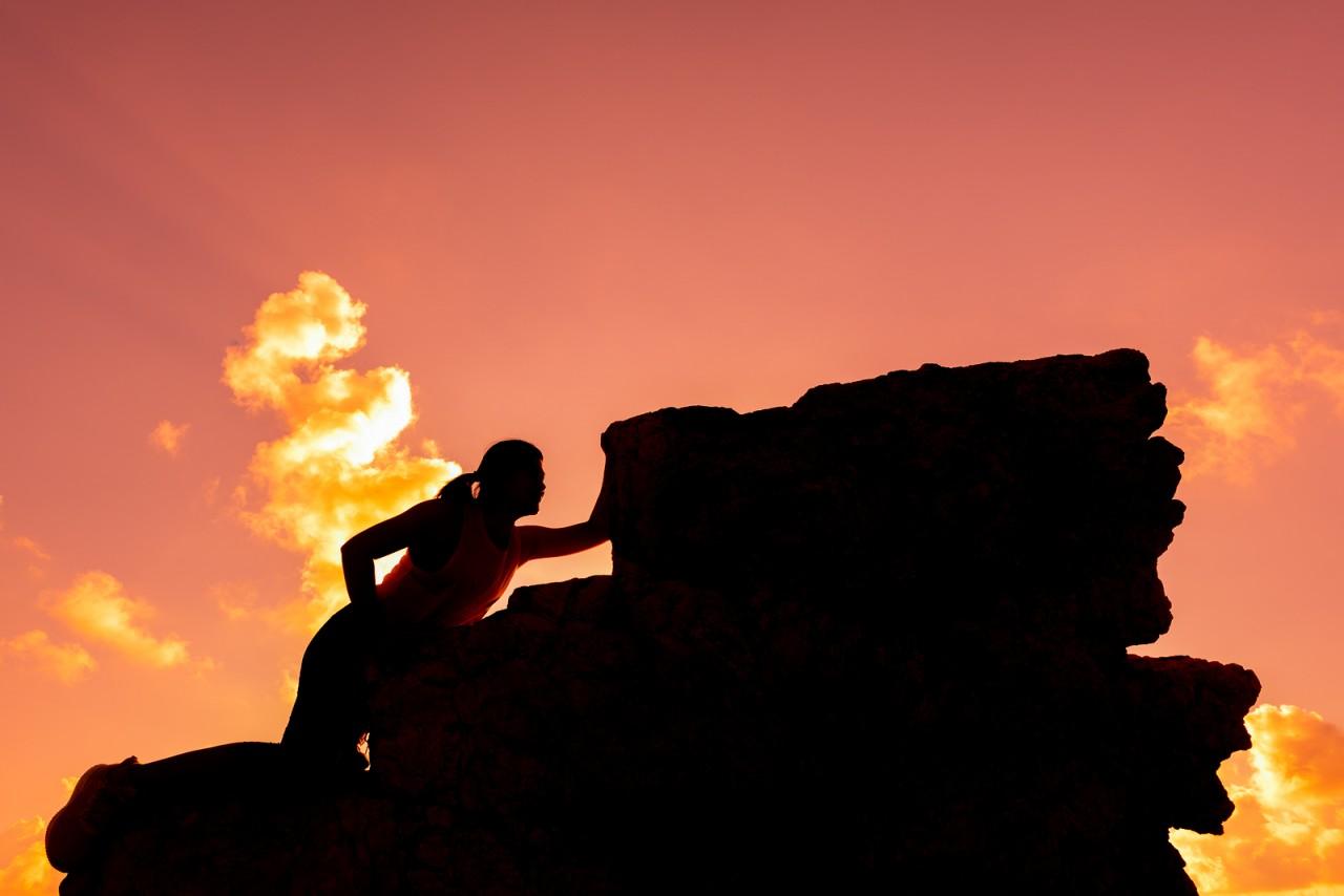bigstock-Silhouette-Sporty-Woman-Climbi-286733875